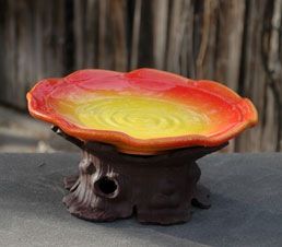 Yellow Birdbath on trunk stand